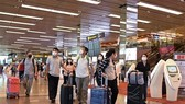 Passengers at Singapore's Changi airport (Photo: AFP/VNA)