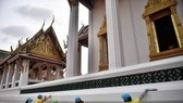 Volunteers and municipal workers clean surfaces at the Wat Suthat Thepwararam temple in Bangkok (Photo: AFP)