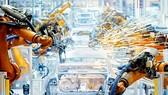 Năm 2025, máy móc đảm trách 52% công việc của con người