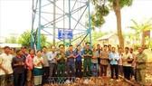 Bàn giao công trình nước sạch vùng biên cho đồng bào xã Thuận An, huyện Đắc Mil, tỉnh Đắk Nông. Ảnh: TTXVN