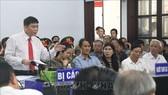 Bị cáo Trần Vũ Hải trả lời chủ tọa phiên tòa. Ảnh: TTXVN