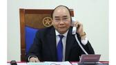 Thủ tướng Chính phủ Nguyễn Xuân Phúc điện đàm với Thủ tướng Australia Scott Morrison. Ảnh: VGP