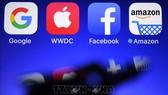 Biểu tượng của Amazon, Apple, Google và Facebook . Ảnh: AFP/TTXVN