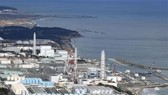 Các bể nước thải có chứa phóng xạ đã qua xử lý tại nhà máy điện hạt nhân Fukushima, Nhật Bản. Nguồn: Kyodo/TTXVN