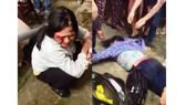 Hình ảnh chị Bảy và Phúc bị nhiều người đánh hội đồng được đưa lên mạng xã hội