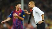 Pep Guardiola (phải) và Lionel Messi có mối quen hệ rất tốt khi còn ởBarcelona. Ảnh: Getty Images