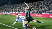 Asensio (đen) là người ghi bàn duy nhất cho Real. Ảnh: Getty Images.