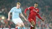 Georginio Wijnaldum (phải) không muốn Liverpool sớm đối đầu Man.City. Ảnh: Getty Images