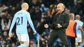David Silva và Pep Guardiola chia sẽ niềm vui sau một chiến thắng. Ảnh: Getty Images