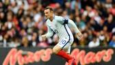 Wayne Rooney khi còn mang băng đội trưởng tuyển Anh. Ảnh: Getty Images