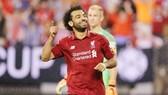 Mohamed Salah mừng bàn thắng trong ngày đầu trở lại đội hình Liverpool. Ảnh: Reuters