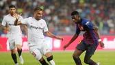 Dembele có màn trình diễn tốt trước Sevilla. Ảnh Reuters.