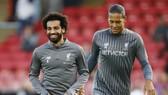 Trung vệ Virgil Van Dijk (phải) và Mohamed Salah trên tuyến đầu đang làm nên sức mạnh của Liverpool. Ảnh: Getty Images