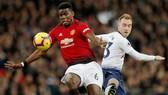 Christian Eriksen (phải, Tottenham) và Paul Pogba (Man.United) là 2 ngôi sao vẫn chưa chắc chắn tương lai cho đến cuối tuần này. Ảnh: Getty Images