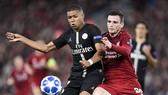 Kylian Mbappe (trái) từng đối đầu Liverpol ở Champions League. Ảnh: Getty Images