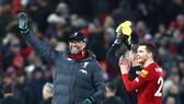 HLV Jurgen Klopp thừa nhận hạnh phúc với màn khởi đầu khó tin. Ảnh: Getty Images