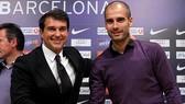 Joan Laporta sẵn sàng hợp tác với Pep Guardiola lần nữa nếu đắc cử Chủ tịch Barca. Ảnh: Getty Images