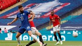 Olivier Giroud tiếp tục sắm vai người hùng cho Chelsea. Ảnh: Getty Images