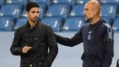 Mikel Arteta hy vọng sẽ tìm thấy phương cách hóa giải thầy cũ Pep Guardiola. Ảnh: Getty Images
