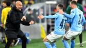 HLV Pep Guardiola dường như đang được tiếp thêm niềm tin từ thành công mùa này. Ảnh: Getty Images