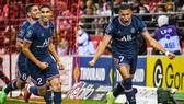 Kylian Mbappe (phải) ghi cú đúp giúp PSG thắng Reims 2-0 hôm Chủ nhật.