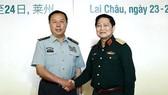 Đại tướng Ngô Xuân Lịch, Bộ trưởng Bộ Quốc phòng Việt Nam tiếp Thượng tướng Phạm Trường Long, Phó Chủ tịch Quân ủy Trung ương Trung Quốc. Ảnh: TTXVN
