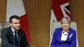 Tổng thống Pháp Emmanuel Macron và Thủ tướng Anh Theresa May. Nguồn: TTXVN