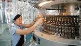 Ngành dệt tiếp cận thiết bị hiện đại để nâng cao chất lượng sản phẩm       Ảnh: THÀNH TRÍ
