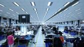 Công nhân sản xuất các mặt hàng may mặc xuất khẩu. (Ảnh minh họa. Nguồn: TTXVN