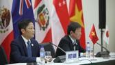 Bộ trưởng Bộ Công Thương Trần Tuấn Anh và ông Toshimitsu Motegi - Bộ trưởng Tái thiết kinh tế Nhật Bản đồng chủ trì họp báo về TPP. Ảnh: VGP