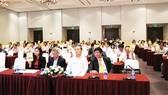 Phó Tổng Giám đốc Nguyễn Minh Sơn nêu lên những thách thức trong năm 2018 tại đại hội cổ đông thường niên. Ảnh: KHẮC MẪN