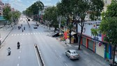 Đường Quang Trung, quận Gò Vấp, lượng xe lưu thông giảm hẳn so với ngày thường. Ảnh: HOÀNG HÙNG