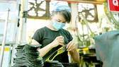 Sản xuất tại một đơn vị ở TPHCM. Ảnh: Hoàng Hùng