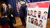 Thứ trưởng Tư pháp Mỹ Rod Rosenstein phát biểu trong cuộc họp báo tại Bộ Tư pháp ở thủ đô Washington ngày 23-3-2018 công bố truy tố 9 công dân Iran. Ảnh: REUTERS