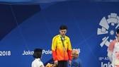 Kình ngư Nguyễn Huy Hoàng đoạt Huy chương bạc nội dung bơi 1.500m tự do nam trong ngày 24-8. Ảnh: DŨNG PHƯƠNG