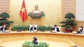 Thủ tướng Nguyễn Xuân Phúc chủ trì phiên họp Thường trực Chính phủ về giải pháp bình ổn giá thịt heo. Ảnh: TTXVN