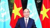 Thủ tướng Nguyễn Xuân Phúc đọc thông điệp gửi tới Phiên thảo luận chung cấp cao của Đại hội đồng Liên hiệp quốc khóa 75. Ảnh: TTXVN