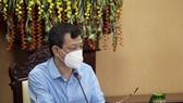 Giám đốc Bệnh viện Chợ Rẫy Nguyễn Tri Thức tại buổi làm việc với UBND tỉnh Kiên Giang về hỗ trợ tư vấn tổng thể đối với hoạt động phòng, chống dịch và điều trị cho bệnh nhân Covid-19 trên địa bàn tỉnh, ngày 24-9. Ảnh: TTXVN