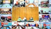 Phó Thủ tướng Vũ Đức Đam làm việc trực tuyến với TPHCM, các tỉnh ĐBSCL và Tây Nguyên về chuẩn bị nới lỏng giãn cách xã hội sau ngày 30-9. Ảnh: TTXVN