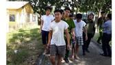 Các học viên trốn trại được công an đưa trở lại trại