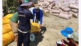 Giá lúa thơm tại huyện Tân Hiệp (Kiên Giang) ngày 6-3 chỉ còn 4.700 đồng/kg. Ảnh: CAO PHONG