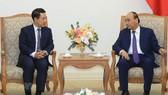 Thủ tướng Nguyễn Xuân Phúc tiếp Bộ trưởng Bộ Ngoại giao Lào Saleumxay Kommasith đang thăm chính thức Việt Nam. Ảnh: Thống Nhất/TTXVN