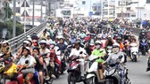 Cần bổ sungquy định về áp dụng tiêu chuẩn khí thải và kiểm soát khí thải đối với xe mô tô, xe gắn máy. Ảnh: THÀNH TRÍ