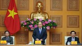 Thủ tướng Nguyễn Xuân Phúc phát biểu tại buổi gặp mặt 124 doanh nghiệp có sản phẩm đạt thương hiệu quốc gia Việt Nam 2020. Ảnh: VGP/Quang Hiếu