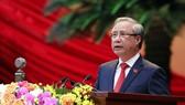 Đồng chí Trần Quốc Vượng đọc Báo cáo kiểm điểm của Ban Chấp hành Trung ương Đảng khóa XII