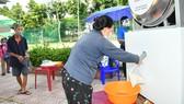 ATM gạo miễn phí cho người nghèo quận Tân Phú bắt đầu từ ngày 5-6-2021. Ảnh: VIỆT DŨNG