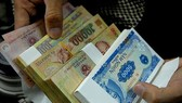 Xử lý việc đổi tiền lẻ dịp tết không đúng quy định