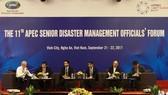 """Hội nghị các Quan chức cao cấp APEC về Quản lý thiên tai lần thứ 11 đã họp phiên toàn thể đầu tiên với nội dung: """"Tổng quát ứng dụng công nghệ thông tin và tăng cường hợp tác vùng trong giải quyết rủi ro thiên tai"""". Ảnh:TTXVN"""