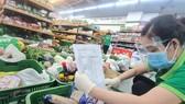 Co.op Food tăng tốc giao hàng cho các đầu mối mua chung bằng nhiều xe buýt