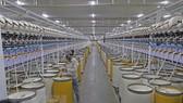 Sản xuất sợi tại Công ty TNHH Dệt Hà Nam, thành phố Phủ Lý, tỉnh Hà Nam. (Ảnh: Trần Việt/TTXVN)